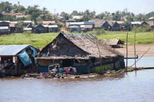 Floating houses make sense down here where the water level will raise and fall more than 10 meters each year.
